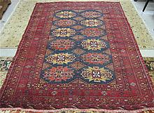 PERSIAN TURKOMAN CARPET, featuring two columns of
