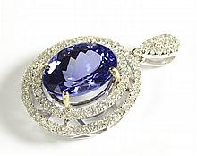 TANZANITE, DIAMOND AND WHITE GOLD PENDANT. The 14k
