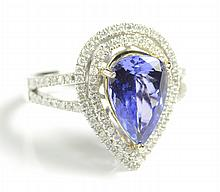 TANZANITE, DIAMOND AND FOURTEEN KARAT GOLD RING,