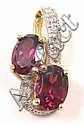 RHODOLITE GARNET AND DIAMOND PENDANT, 14k gold set