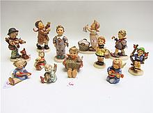 TWELVE HUMMEL FIGURINES, soft past porcelain: TM-2