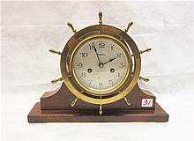 BRASS SHIP'S CLOCK ON WALNUT STAND, Waterbury