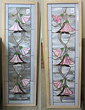 A PAIR OF STAINED AND LEADED GLASS WINDOWS, a