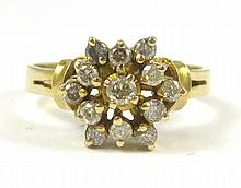 DIAMOND AND FOURTEEN KARAT GOLD RING, set with 13