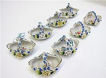 EIGHT GERMAN CERAMIC SALT BASKETS, all with