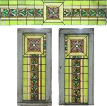 A SET OF THREE STAINED AND LEADED GLASS WINDOWS, A
