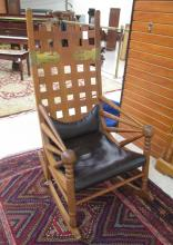 AN UNUSUAL OAK ROCKING CHAIR, design attributed to