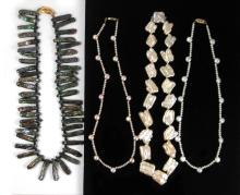 FOUR PEARL NECKLACES, the first a dark green stick