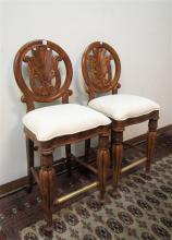PAIR OF CARVED MEDALLION-BACK BAR STOOLS, Pulaski