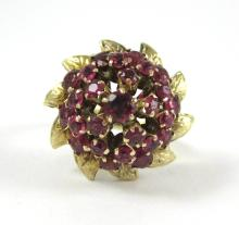 RUBY AND EIGHTEEN KARAT GOLD CLUSTER RING, with a
