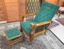 AN OAK 'MORRIS' ARMCHAIR WITH FOOTSTOOL, American,