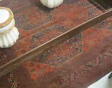 AFGHAN TRIBAL CARPET, the red field featuring four