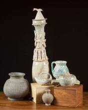 SIX POTTERY VESSELS:  a Chinese celadon funerary