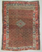 SEMI-ANTIQUE KURDISH TRIBAL AREA RUG, central diam