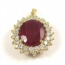 RUBY, DIAMOND AND FOURTEEN KARAT GOLD PENDANT,