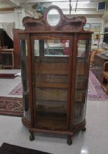 AN OAK AND CURVED GLASS CHINA CABINET, Larkin Co.