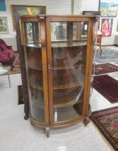 AN OAK AND CURVED GLASS CHINA CABINET, Rockford Ch