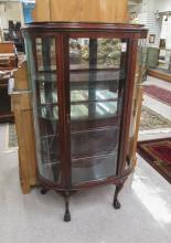 LATE VICTORIAN MAHOGANY AND CURVED GLASS CHINA CAB