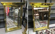 A PAIR OF VICTORIAN STYLE BRASS-FRAMED WALL MIRROR
