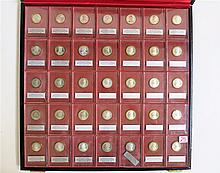 STERLING SILVER PRESIDENTIAL COIN SET, The Franklin Mint, 1967, featuring 32 sterling silver coins each representing a U.S. President, Presidents #1 through 32, each coin in original clear plastic case, the set displayed in original Franklin Mint