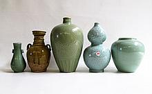 FIVE ORIENTAL POTTERY VASES of various forms including double-gourd, Mei Ping, split handle and high shoulder. Each are glazed and ornamented in their own unique treatment. Each height from 6 to 11 inches.