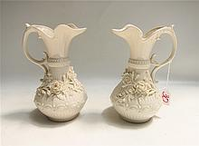 PAIR BELLEEK ABERDEEN  PORCELAIN EWERS, with applied flowers in opposing position. Fifth Mark (1955-1965). Height 9 inches.