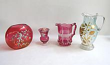 FOUR PIECES OF COLORED VICTORIAN GLASS consisting of an enamel painted pitcher, a flash treated pitcher and two flash vases with enamel  white floral treatment. Heights from 5 to 11.5 inches.