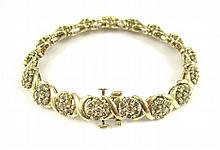 DIAMOND AND TEN KARAT YELLOW GOLD BRACELET, measuring 7-1/2 inches in length, set with 118 round-cut diamonds together weighing approximately 7.67 cttw. Bracelet weight: 22.9 grams.