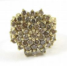 DIAMOND AND FOURTEEN KARAT GOLD CLUSTER RING.  The gold nugget setting featuring a cluster of 41 round-cut diamonds together weighing approximately 1.44 cttw.  Ring size:  6-3/4.