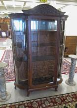 LATE VICTORIAN CARVED OAK AND CURVED GLASS CHINA C