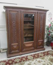 LARGE THREE-DOOR CARVED OAK BOOKCASE, German, c. 1