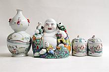 FOUR PIECES OF CHINESE CERAMIC consisting of a Famille Verte Buddha with children, two lidded jars and one cinched waist bottle with tributary reign mark. Heights from 4.5 to 10 inches.