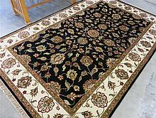 HAND KNOTTED ORIENTAL CARPET, Indo-Persian, floral Isfahan design on rectangular midnight blue field with cream border, 6'0