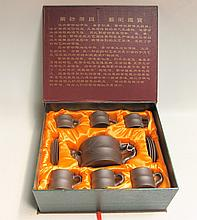 BOXED CHINESE REDWARE TEA SET, thirteen pieces consisting of 1 tea pot, 6 cups and 6 saucers, fitted in original box. Yang Shi Xiong De Zi Sha.