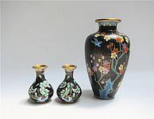 THREE CHINESE CLOISONNE VASES, the largest with  colorful bird and blossoming prunus tree on black diapered ground, 9.25