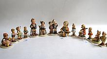 THIRTEEN HUMMEL FIGURINES with date marks from 1972 to present. Titles include Little Goat Herder, Little Hiker, Chick Girl, Max and Moritz, Thoughtful, Two Hands-One Treat, I Brought You a Gift, Honor Student, Good Tiding, Lucky Charmer, Sunflower