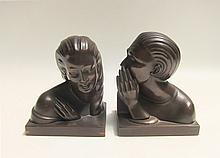 PAIR OF JENNINGS BROTHERS FIGURAL BOOKENDS, one  of a head and shoulder of a man whispering and the other of a woman in a gestural pose. Heights 5.5 inches.
