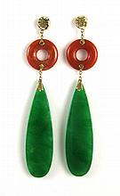 PAIR OF JADE DROP EARRINGS WITH FOURTEEN KARAT GOLD MOUNTS having a lavender and moss green jade palate. Length 2 3/4 inches.