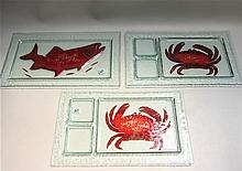 THREE STUDIO ART GLASS SEAFOOD PLATTERS, pair having red crab motif, both signed by artist Sandie Charlton, 17
