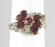 RUBY, DIAMOND AND FOURTEEN KARAT GOLD RING, with six pear-cur rubies and ten round-cut diamonds set around one round-cut ruby. Ring size: 5-1/2.