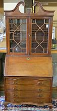 CHIPPENDALE STYLE MAHOGANY SECRETARY BOOKCASE, Maddox Furniture Co., Jamestown, New York, mid-20th century, featuring a slant-front desk with cabinet bookcase above and four serpentine  drawers below.  Dimensions: 84