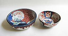 TWO MEIJI JAPANESE IMARI PORCELAIN BOWLS, the first of traditional form with a central floral  reserve and diaper floral panels, diameter 7 inches. The second of a flying phoenix over a still-life of baluster form vases, diameter 9.5  inches.