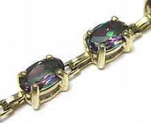 MYSTIC TOPAZ AND TEN KARAT GOLD BRACELET, set with 21 oval-cut mystic topaz together weighing  approximately 4.83 cttw. Bracelet length: 7-1/4  inches.