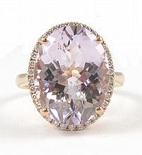 PINK QUARTZ, DIAMOND AND ROSE GOLD RING. The 14k rose gold ring with round-cut diamonds set around an oval, checkerboard-cut pink quartz weighing approximately 8.27 cts. Estimated weight for all diamonds: 0.32 cttw Ring size: 7.