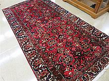 SEMI-ANTIQUE PERSIAN TRIBAL AREA RUG, Hamadan Province, northwestern Iran, hand knotted in an  overall Herati floral design on red ground, 4'9