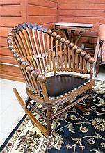 AN OAK 'LOLLIPOP' ROCKING CHAIR in the manner of