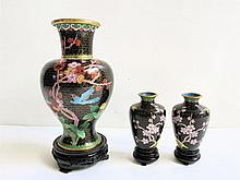 THREE CHINESE CLOISONNE VASES raised on hardwood