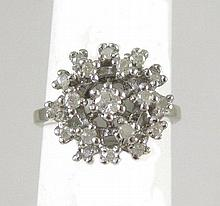 DIAMOND AND TEN KARAT WHITE GOLD CLUSTER RING, set