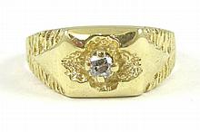 MAN'S DIAMOND AND FOURTEEN KARAT GOLD RING, set