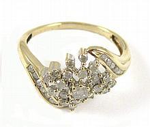 DIAMOND AND TEN KARAT GOLD RING, set with 23